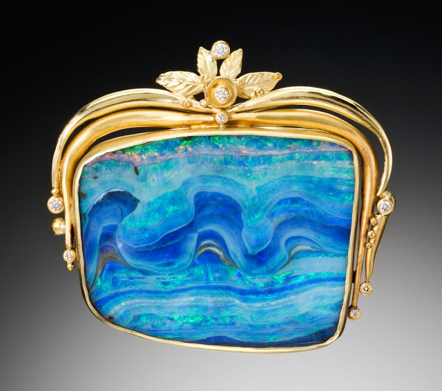 """Gorgeous full-page pic of Judith Kaufman's Opal Wave Gold Brooch. Says Kaufman, """"There's such joy in finding beautiful materials to work with, and then letting myself be as loose and free with them as possible, as if I'm painting with fire, stones and gold."""""""