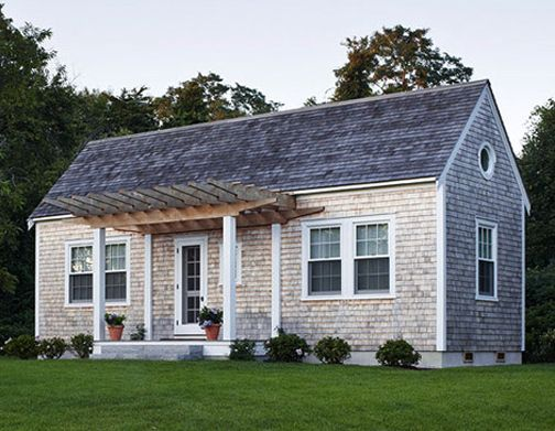 I love this clean lined shingle cottage with porch pergola...