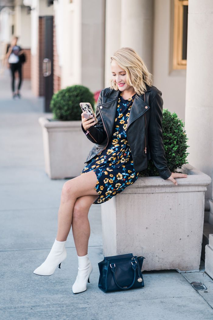 e2a82ff1015a1 Obsessing over this floral mini dress with white boots! I am seeing white  booties EVERYWHERE right now! @thestyleeditrix
