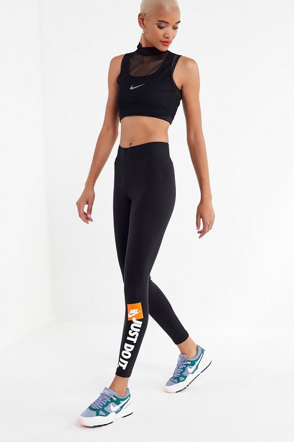 1bdd3bbdffde2c Shop Nike Sportswear Just Do It Legging at Urban Outfitters today. Discover  more selections just like this online or in-store. Shop your favorite  brands and ...