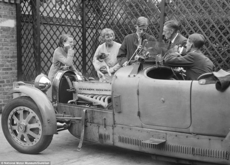 A Group Of People Stand And Chat Around Bugatti Type 43 While Mechanic