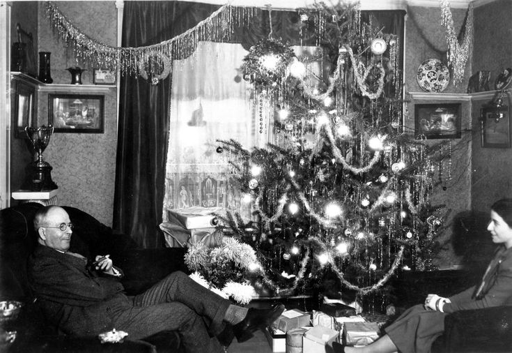 L.D. Taylor and Katherine Federici Sitting in Granville Mansion living room at Christmas, 1930s. (Photo via Vancouver Archives)