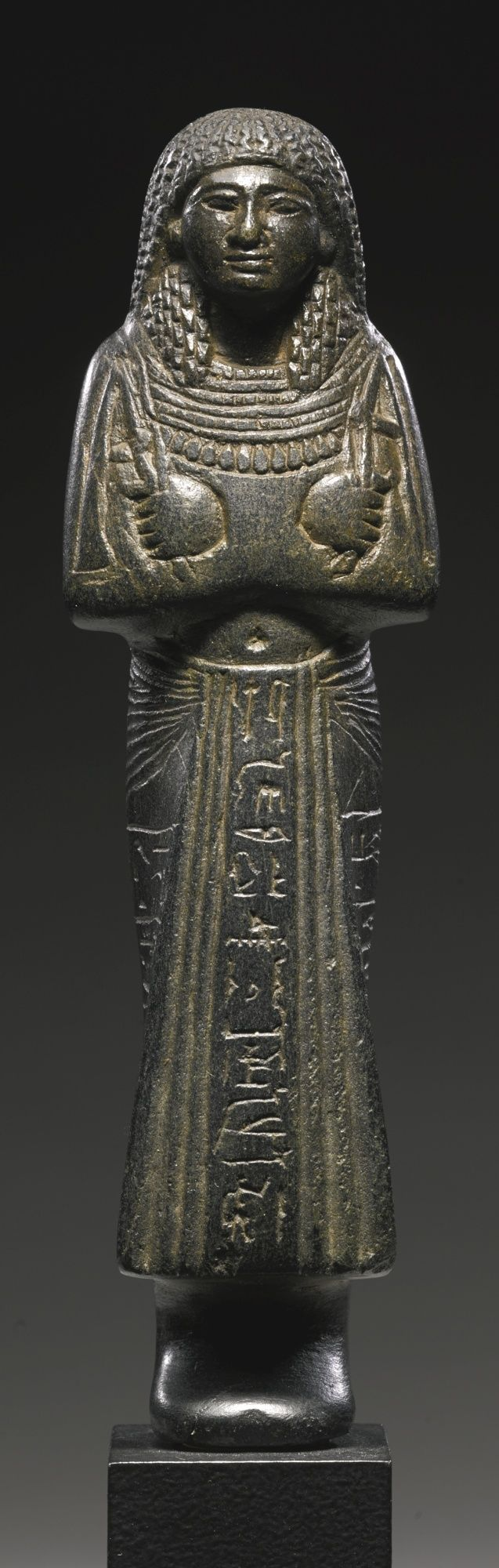 An Egyptian Serpentine Ushabti of Kenj, 19th Dynasty, 1292-1190 B.C. | lot | Sotheby's: