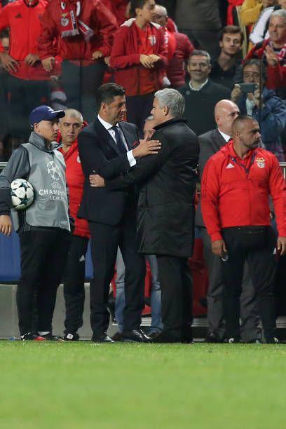 Manchester United's Portuguese head coach Jose Mourinho hugs Benfica's head coach Rui Vitoria during the UEFA Champions League football match SL...