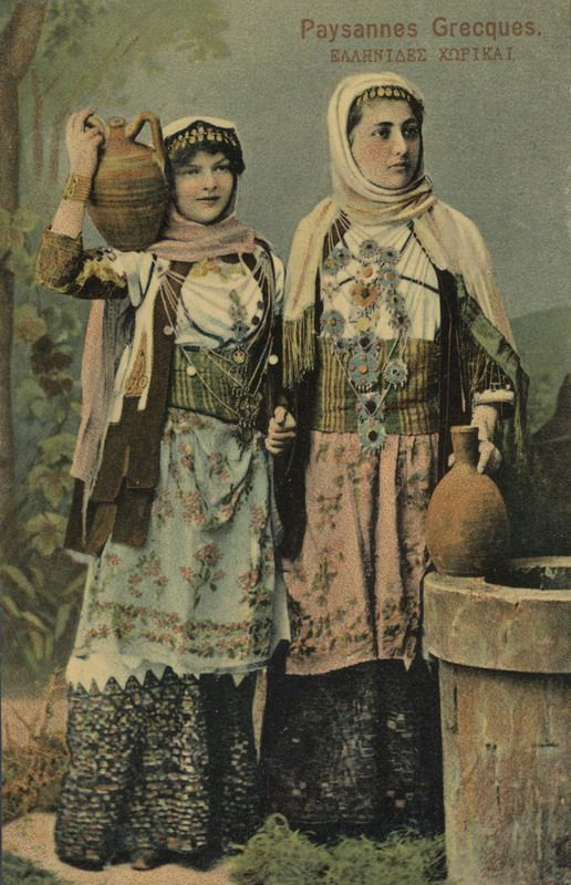 1900-1910 Creator Razis George , Tinted photo of two women with local costumes from Attica, Greece. Inscriptions: Paysannes Greques. ΕΛΛΗΝΙΔΕΣ ΧΩΡΙΚΑΙ, ΕΛΛΑΣ- GRECE, CARTE POSTALE, Georges Razis Editeur, Athenes.