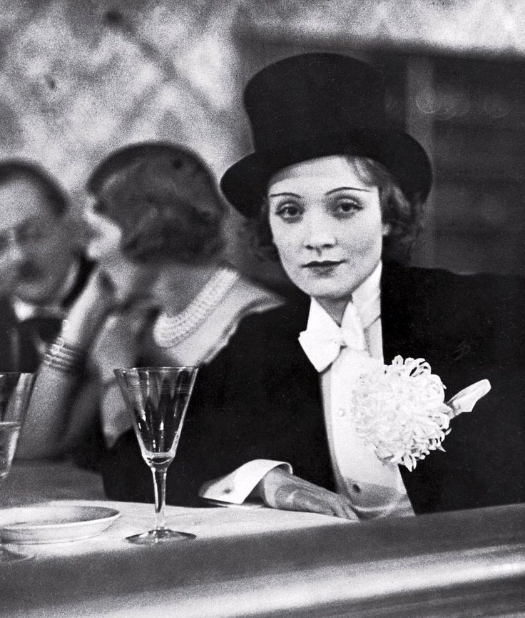 Marlene Dietrich wearing white tail and top hat at ball for foreign press, photo by Alfred Eisenstaedt, Berlin, Germany, 1929