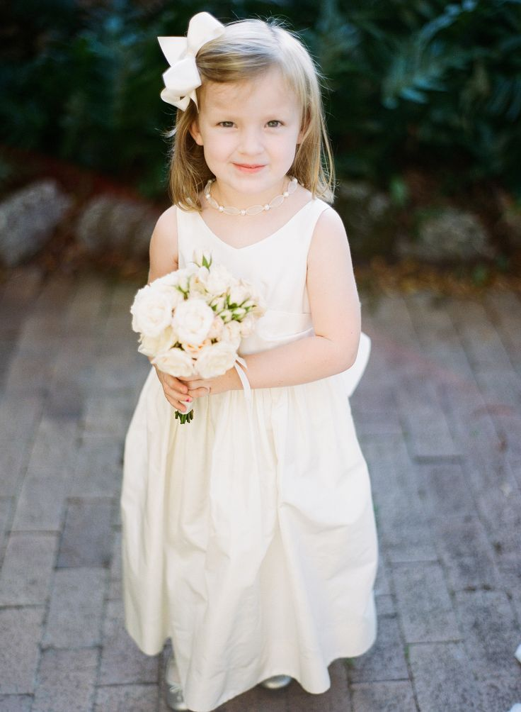 Flower Girl -- CLASSIC! More on SMP: http://www.StyleMePretty.com/2014/05/22/croalgables-traditional-wedding/ Photography: JulieCate.com