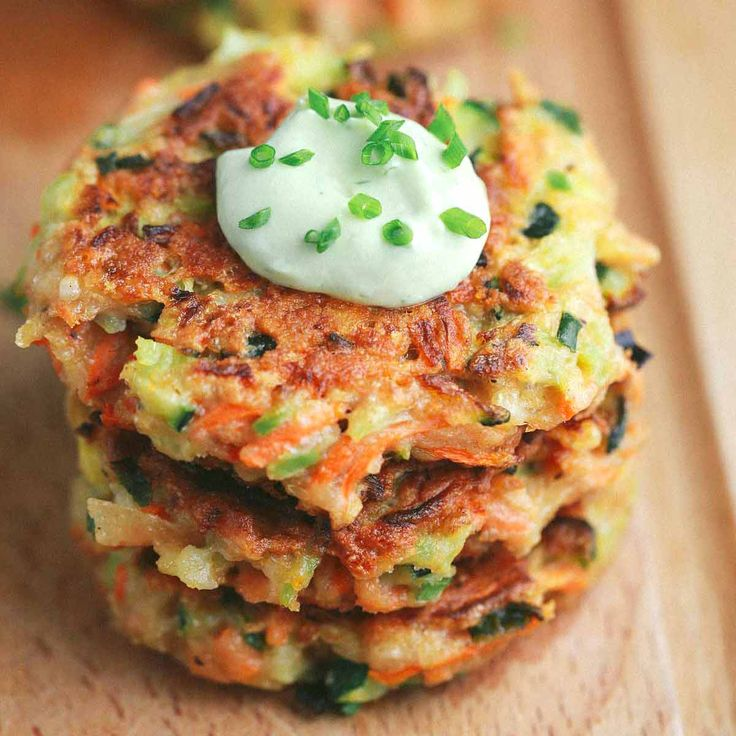 A crispy vegetable fritters recipe packed with broccoli, carrots, and zucchini. Dip each delicious appetizer fritter into the creamy avocado yogurt sauce.