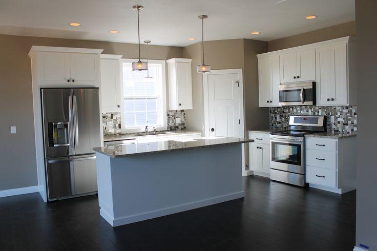 5322 white kitchen with large center island. Kitchen Layout: L-shaped. Description: Spacious corner pantry ...