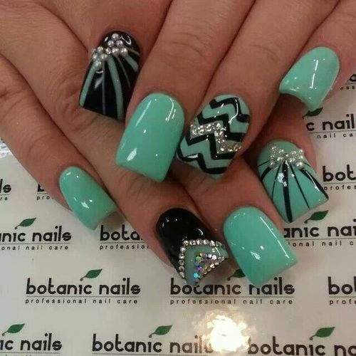 Gel nails with green, black ,and silver nail art.