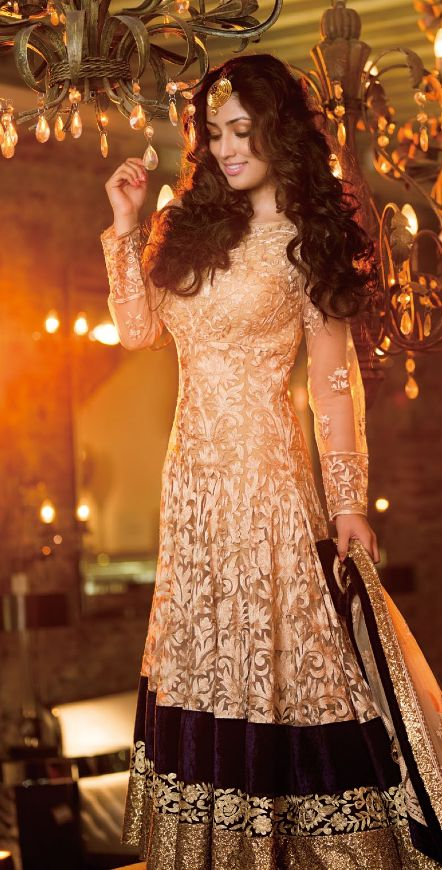 Peach anarkali with a black ad gold border