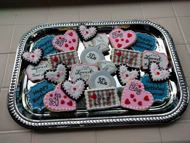 Royal icing, stamped, wafer paper & fondant used to make these cookies!  Baked to a Tea