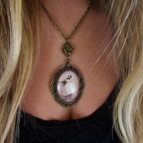 Set in a vintage frame with a pretty rose charm this very feminine and unique ballerina pendant is the perfect gift for Mothers birthday