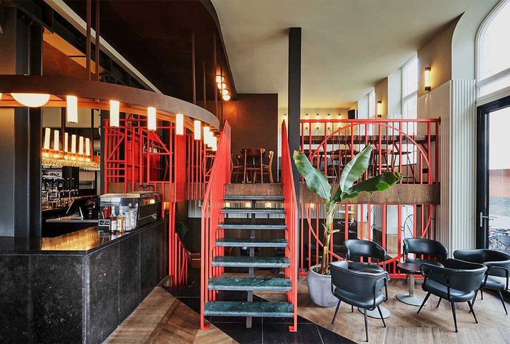 Studio Modijefsky have designed the interior of Holy Smoke, a new Bar & Restaurant set in a historic building on the corner of Tiendplein in Rotterdam.