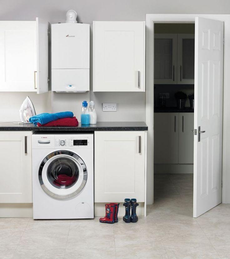 Выбираем накопительный водонагреватель: советы по выбору объема и сравнение наиболее экономичных моделей http://happymodern.ru/vodonagrevatel-nakopitelnyj/ Электрический водонагреватель, замаскированный в прачечной за дверцей