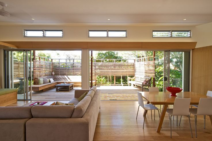 Conversion of 1990s brick and tile beach house to a modern, open-plan sustainable living environment. Designed to optimise northern solar access, cross-ventilation, and thermal comfort without heating or air conditioning. Situated on a small block across from Tallows Beach, Suffolk Park NSW