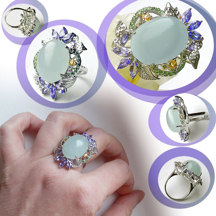 An exquisite piece of jewelry, valuable and elitist Vintage Statement Ring, adorned with Authentic Precious Gemstones: Natural Bluish Green Aquamarine from Santa Maria Brazil, Natural Tanzanite from Tanzania, Natural Green Tsavorite Garnet from Tanzania, Natural Yellow Sapphire from South Africa.