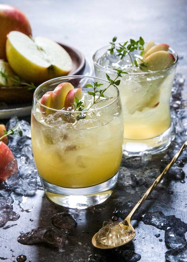 Honeycrisp & Apple Cider Bourbon Shrub is the perfect fall cocktail. Juicy, honeycrisp apples mixed with bourbon, fresh ginger, and kombucha is a delightful drink to sip on while enjoying the cooler weather!