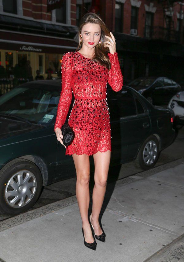 Model Miranda Kerr stepped out in a red lace Dolce & Gabbana dress