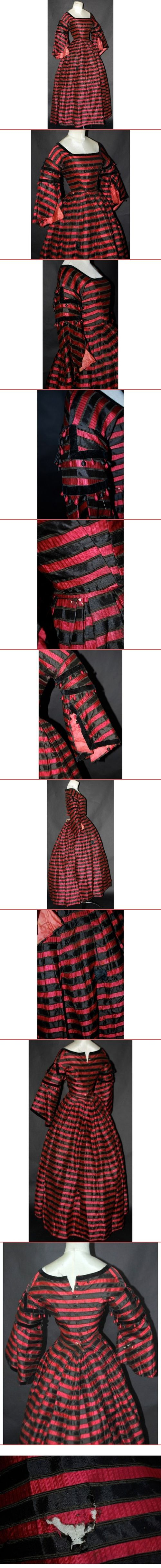 1860s dress, 2 pc construction. The fabric is a red stripe textured silk with black silk satin stripes. The bodice closes in the rear, trimmed in buttons, several are missing.  The skirt is cartridge pleated in rear, layered box pleats in the front, falli - created via http://pinthemall.net