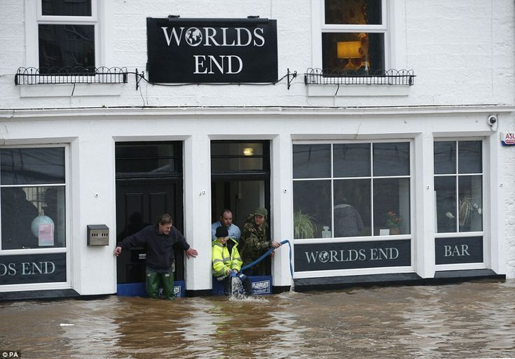 Worlds End: People could be seen pumping floodwater out of a pub in Dumfries today after t...