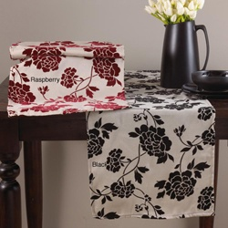 Black and white table runner with grey tablecloths.