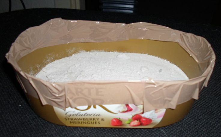 Sandbath for my hamster Poro made out of an empty ice cream bin.