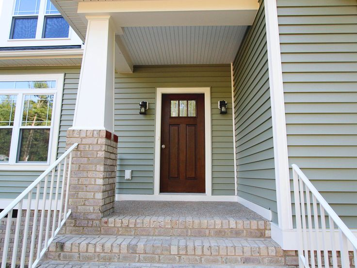 Classic Entryway With White Trim Sage Green Siding And