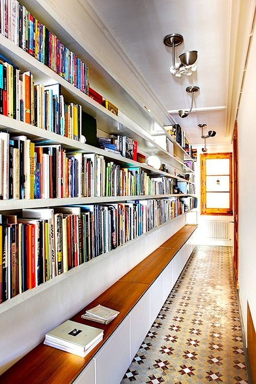 I love the idea of bookshelves in the hallway! Not enough wall space, hallways are always extra wide, 2 birds with one stone.