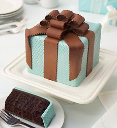 Sam Godfrey Perfect Endings Present Cake Perfect Endings Present Cake is made from gourmet chocolate, filled with chocolate truffle cream, and shaped as a gift box surrounded by a Belgian white chocolate ribbon and bow!