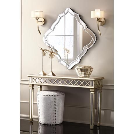 Brighten up a dreary or unused wall space with this delightful, classical-inspired mirror and silver console table.