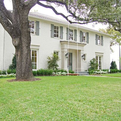 Benjamin Moore Ballet White with Altitude Gray.  Windows match the main house color. Shutters are the lone color.