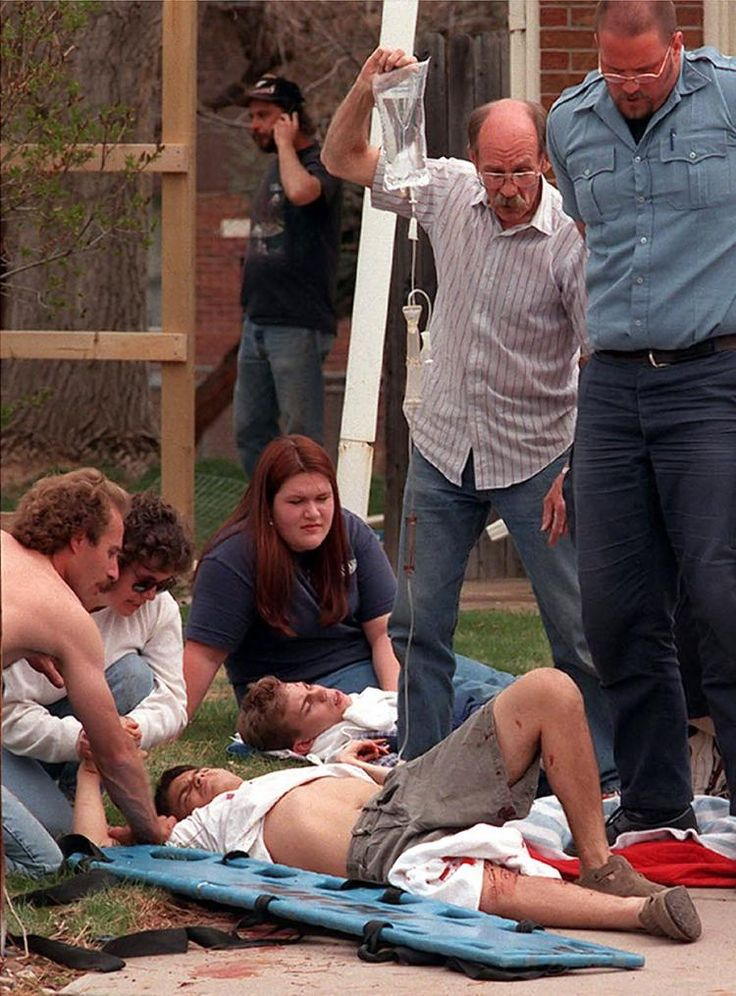 Emergency workers tend to the wounded at a triage scene near the school shooting at Columbine High School in Littleton, Colo.