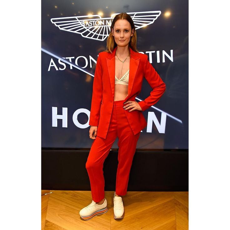 Graceful in red @charlottedecarle at the #ASTONMARTINxHOGAN event during #LFW