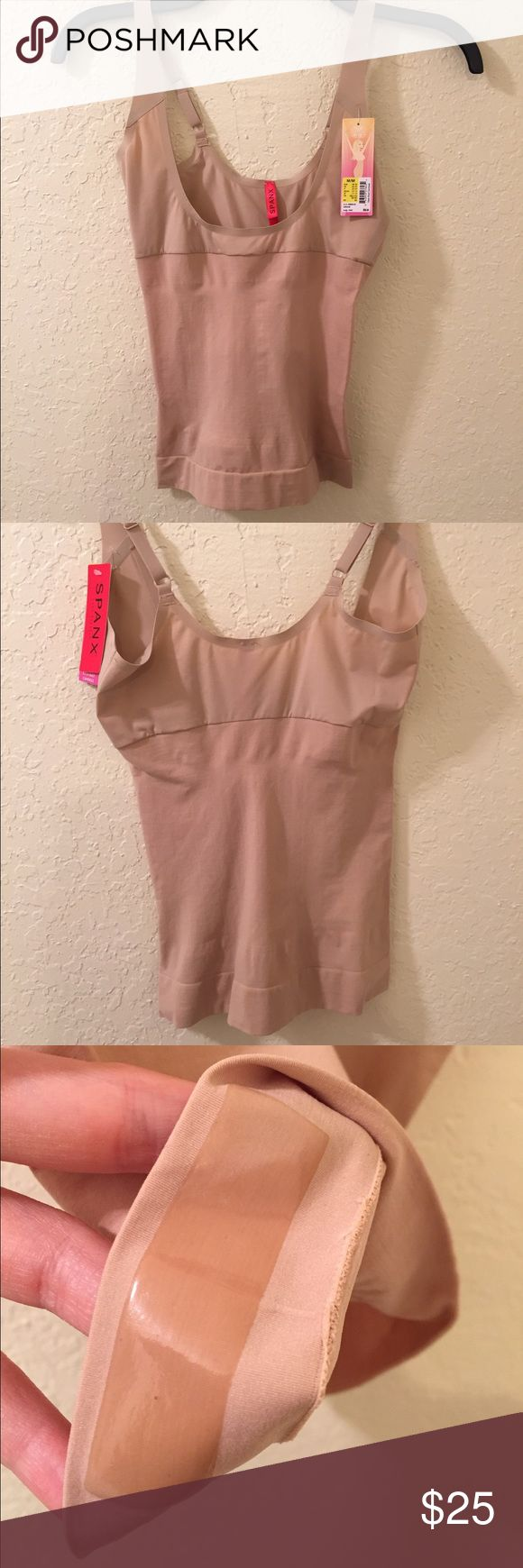 Spanx NUDE/BEIGE Open-Bust Camisole *NWT* This open-bust design allows you to wear your own bra while zeroing in on any trouble spots. It runs small so would work for someone looking for a small or a tight medium. Never been worn but has some dust marks that will come out after washing (pictured above). Has two sticky patches to ensure the garment stays in place. Spandex/Nylon material. SPANX Intimates & Sleepwear Shapewear