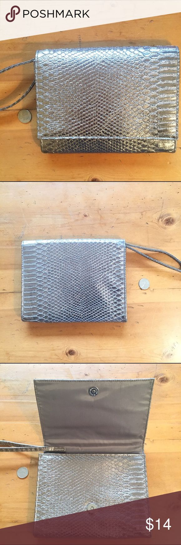 Nieman Marcus Wristlet Great condition silver inside wipes clean 7 1/2 in deep 9 in deep wear with or without Wristlet strap wonderful basic or dressed up 💕 Neiman Marcus Bags Clutches & Wristlets