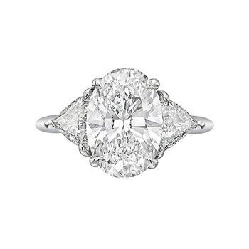 Tiffany & Co. Oval-Cut Diamond Ring with two triangular-shaped brilliant-cut diamond shoulders weighing approximately 1.00 total carats, mounted in platinum, circa 2004