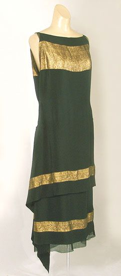 Oh, another LBD. Callot Soeurs couture dress of black silk with bands of gold lamé, c.1924