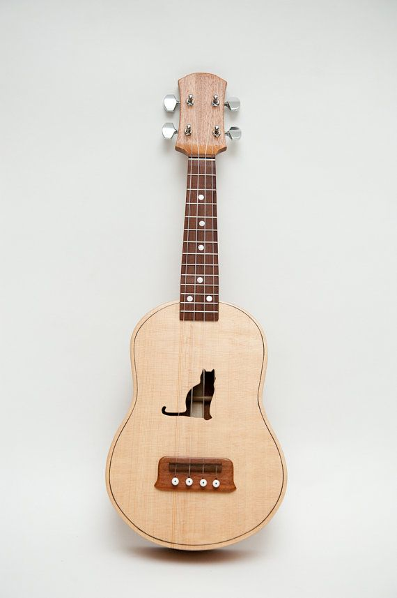 cat concert ukelele. This is soo cool. I have a new ukele but I can't figure out what I want to call her. My first was called Eula.