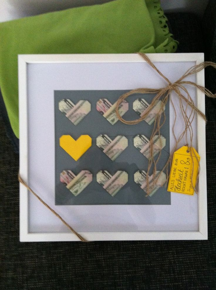 Awesome idea to give money as a gift: Do origami hearts, frame them, add colorful accents with a cool note! Cute.