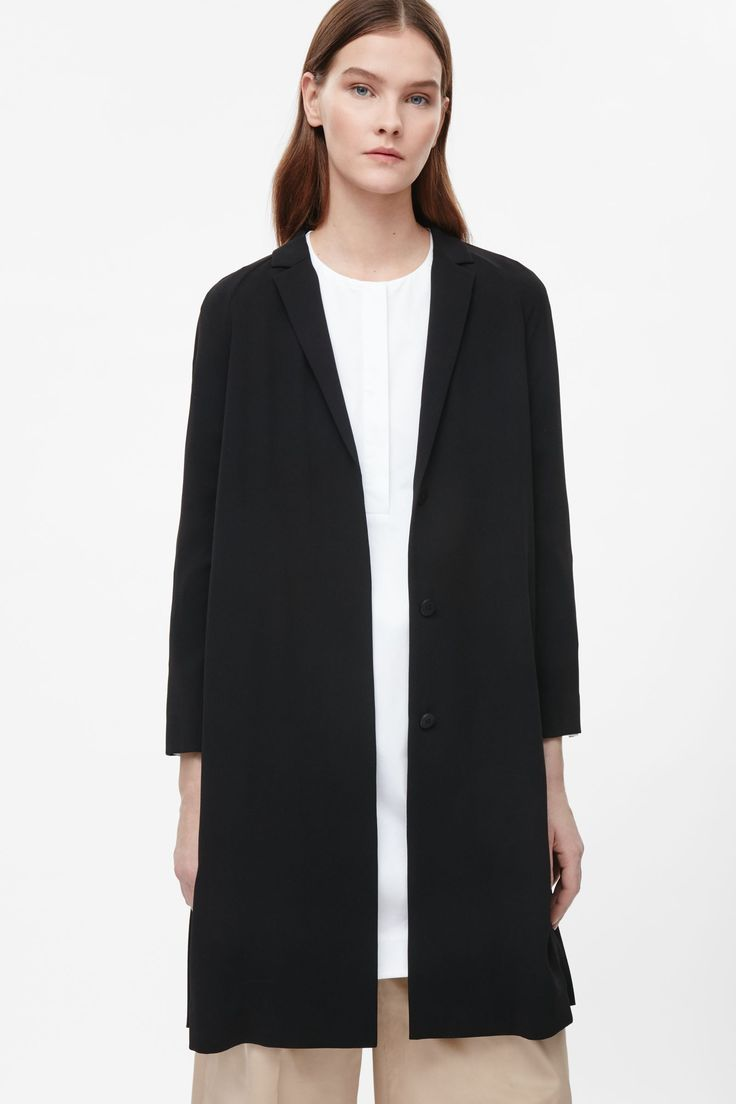COS image 2 of Pleated back blazer in Black
