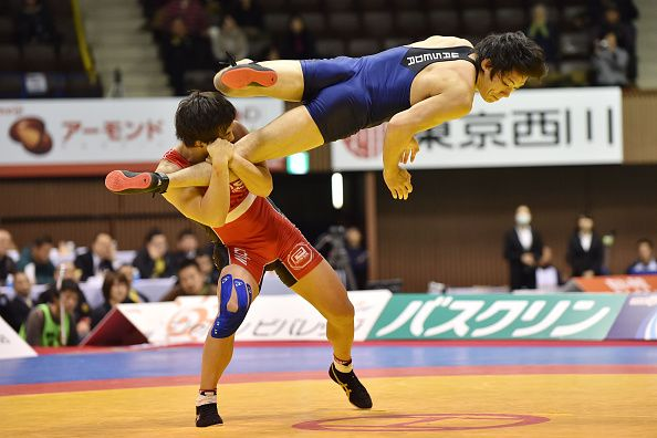 Takafumi Kojima (Red) and Nobuyoshi Takojima (Blue) compete in the Men's 70kg free style final during 2014 Emperor's Cup All Japan Wresting Championship on December 22, 2014 in Tokyo, Japan. (Photo by Atsushi Tomura/Getty Images)