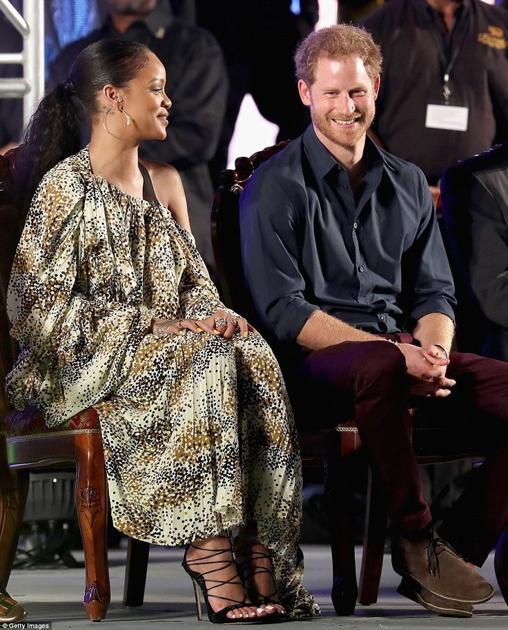 Prince Harry and Rihanna appeared to be fast friends on Wednesday night as they attended t...