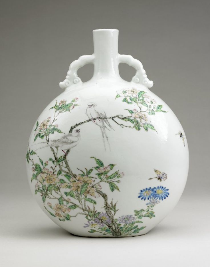 Bottle-shaped flask with flattened globular body and short narrow cylindrical neck with two cloud scroll handles joining neck and shoulder. Fine white porcelain with slightly undulating 'chicken skin' glaze painted with 'famille rose' enamels with bird and flower design.