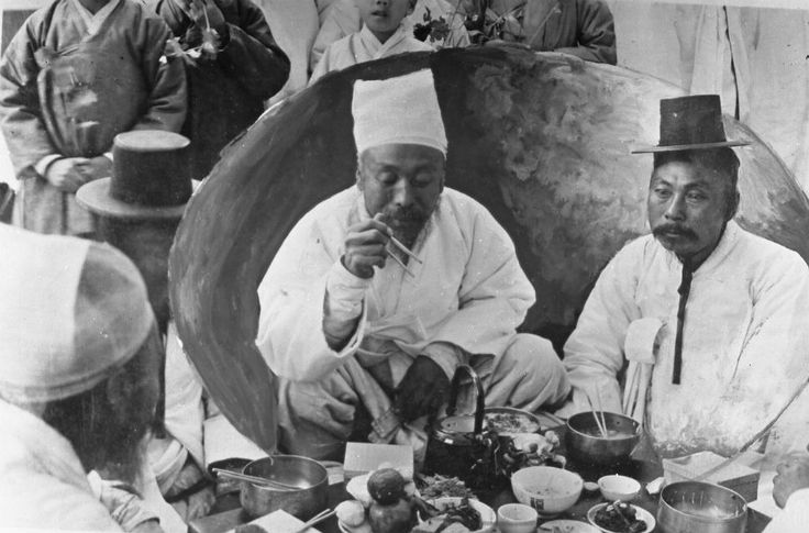 A man dines on a traditional Korean meal, composed of small dishes and rice. Prior to the Japanese occupation, the peninsula was divided into administrative provinces that largely retained regional cuisines. Today, the food around Pyongyang consists of grains and meat dishes designed for enduring the country's notoriously harsh winters. Food shortages are common in the Hermit Kingdom due to mismanagement and a lack of arable land.
