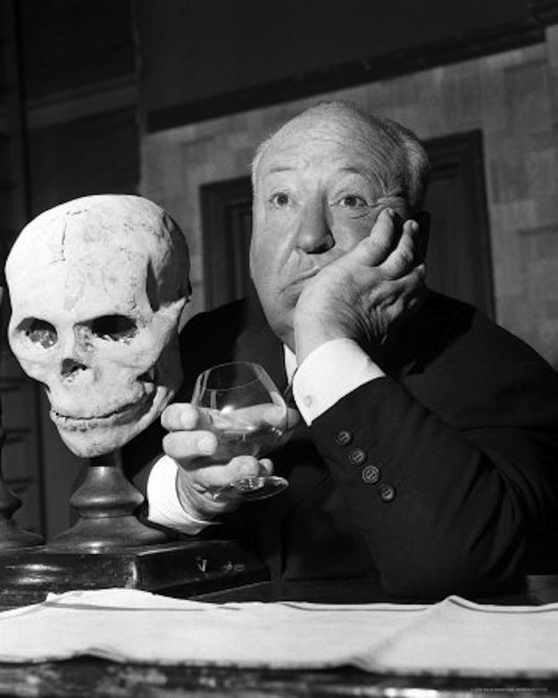Alfred Hitchcock - The geeky weirdo of the past - Sighing next to a skull. I <3 Him!!