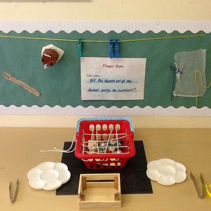 Webtastic finger gym! Children have to use tweezers to remove various sized and shaped objects from the web!