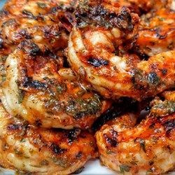Marinated Grilled Shrimp - 3 cloves garlic, minced 1/3 cup olive oil 1/4 cup tomato sauce 2 tablespoons red wine vinegar 2 tablespoons chopped fresh basil 1/2 teaspoon salt 1/4 teaspoon cayenne pepper 2 pounds fresh shrimp, peeled and deveined. Made 12/23/15. So good! I added a little extra basil- fresh is a must!
