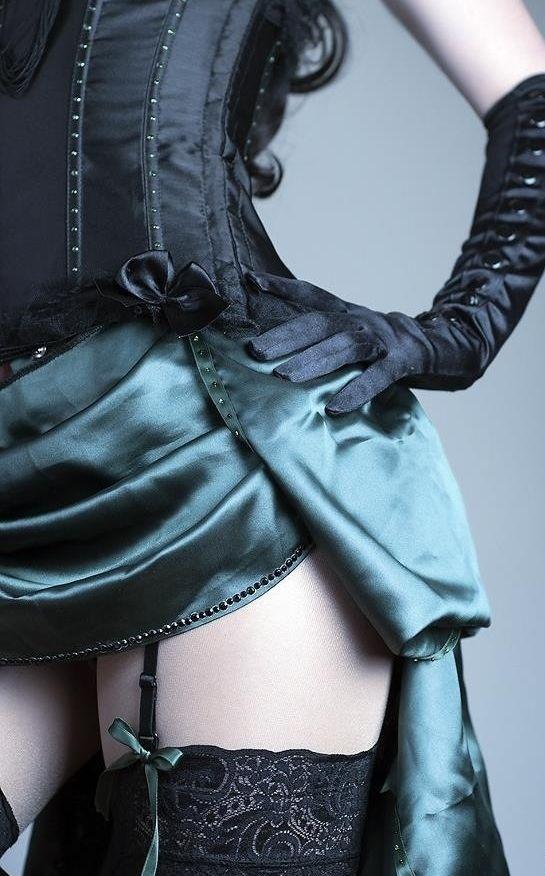 Short bustle skirt, garter belt and thigh highs.