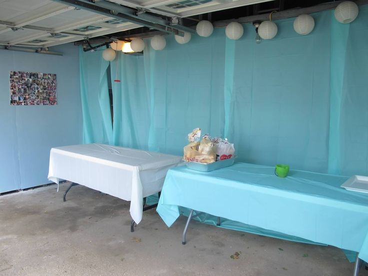 Buffet tables set up in the garage.  Hung paper lanterns and string lights to make it more festive!